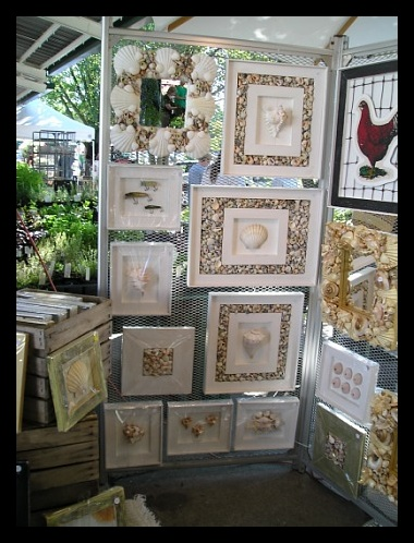 """This is part of my Summer Display at the Ann Arbor Farmers Market which includes """"Seashell Mirrors"""" and other wall decor. One of my best sellers is the """"French Provance Hen"""" in the upper right hand corner."""
