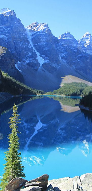 Blue pool of Moraine Lake blue sky water nature mountains rocks lake view reflection mirror seasons