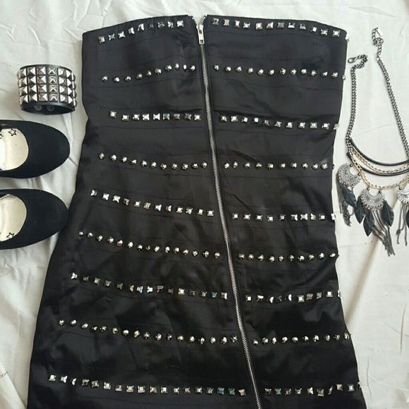 Black studded dress with zipper Very cute for a night out. Zipper on front does zip up and down. Was a gift for me but was too big. I'm 5'5'' and it hit above my knees. Dresses Mini