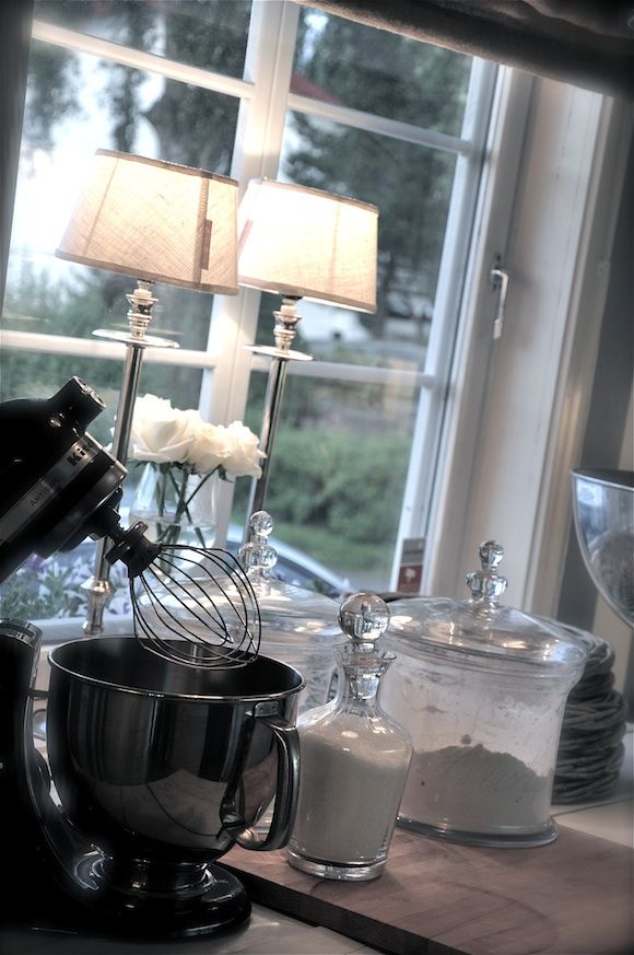 i like the glass jars for flour, sugar etc. also like the candlestick lamps or topi arises on the window sill