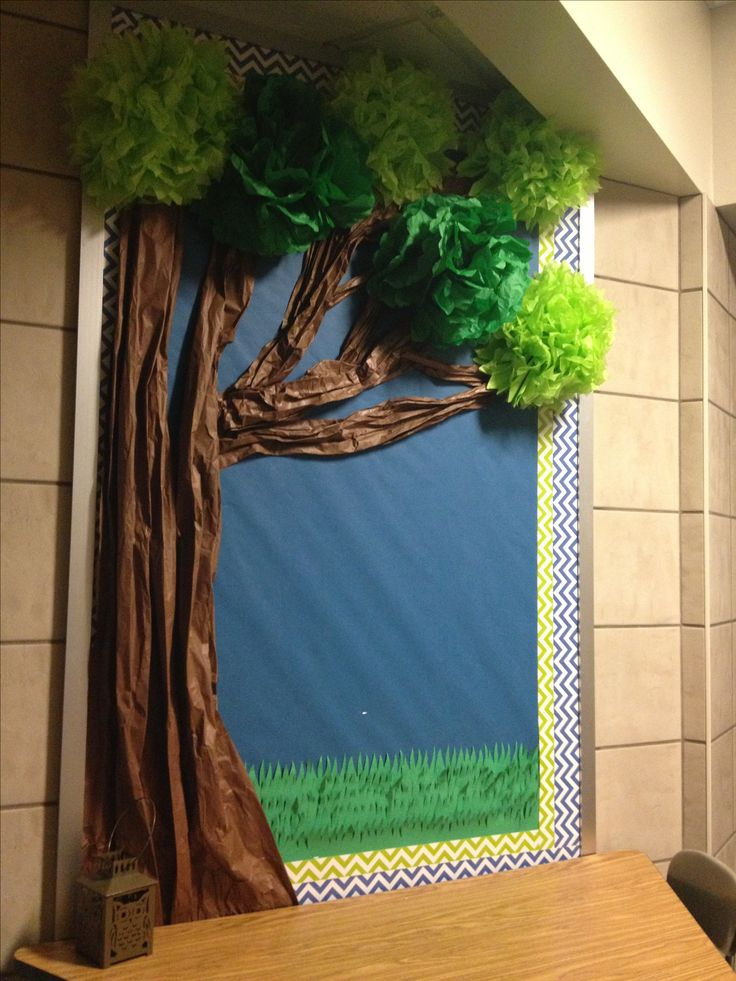 Year long bulletin board.  Trunk made from brown butcher paper.  Leaves made from tissue paper flowers from Party City. Summer: green tissue; Fall: orange, red, brown tissue; Winter: bare branches; Spring: pink tissue