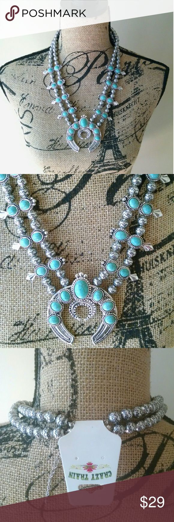 """Crazy Train Necklace Turquoise Sahara Blossom Crazy Train Sahara Blossom Necklace Turquoise Silver Horseshoe Western Cowgirl  Beautiful Crazy Train Sahara Blossom Necklace  Turquoise and silver color  From clasp to the end of the horseshoe drop 14""""  ? We are an authorized retailer or Crazy Train items. If you need something you cannot find, please send us a message! Crazy Train  Jewelry Necklaces"""