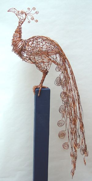 Copper Peacock, 2005. Made from copper wire, wooden fence post; by artist Barbara Franc