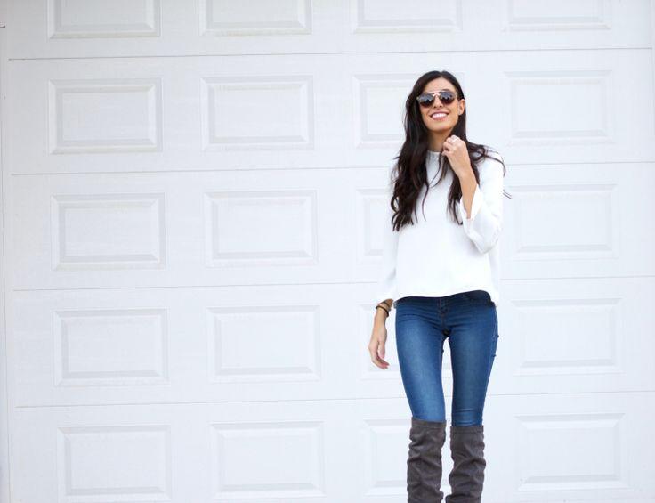 midilema.com | Simply yet chic | Claudia Peris is wearing off white faux fur coat, white feminine blouse, skinny jeans, over-the-knee gray boots. Casual chic. // Claudia Peris lleva abrigo de pelo sintético crema, blusa blanca femenina, pantalones vaqueros pitillo, botas por encima de la rodilla de color gris.