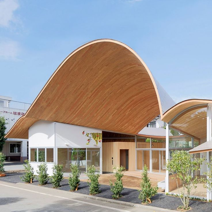 Plywood was used by Takashige Yamashita to create the dramatic undulating roof of this nursery in Japan's Yamanashi prefecture. The laminated-veneer-lumber rafters are sandwiched between layers of structural plywood to add rigidity to the overall roof structure and ensure it is able to achieve spans of up to ten metres.
