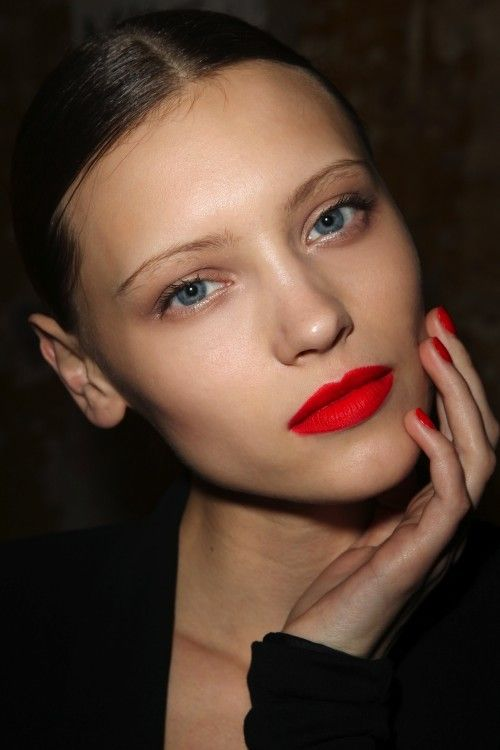 Bright matte lips, bare eyes.