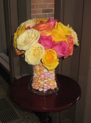 replace multi color almonds with turquoise ? and keep the roses just peach and yellow ? Wedding floral arrangement - yellow, peach, pink, ivory roses.
