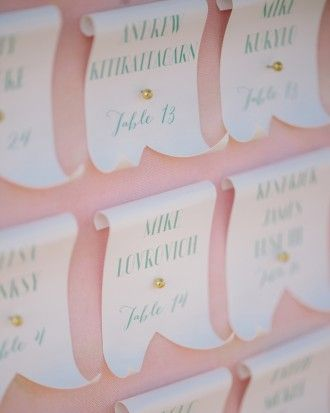 Calligraphed escort cards pinned to a refurbished frame directed guests at this garden-party wedding in San Francisco. Follow the link to check out more of Alex and Brandon's big day!