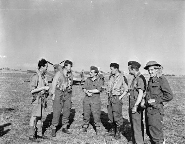 """Operation TORCH: Squadron Leader R """"Raz"""" Berry (third from left), the Commanding Officer of No. 81 Squadron RAF, with some of his pilots at Maison Blanche, Algeria, after flying in from Gibraltar to commence operations on the first day of the invasion."""