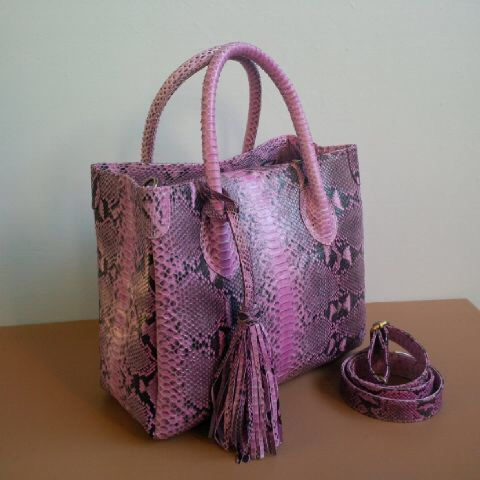 Python skin baby pink Sak... Available at Balinesian ethnic purses Facebook. $165 real leather, man made, good quality