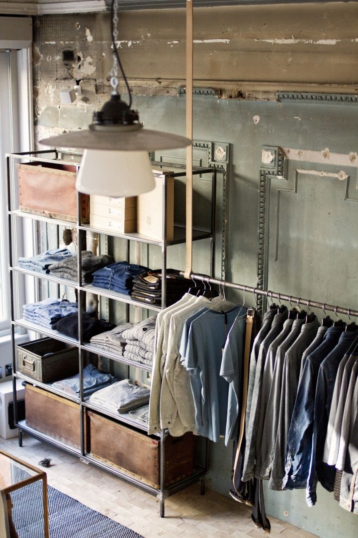 Nudie Jeans store & Global Repair Station, London The interior features raw and rustic vintage furniture set against a clean backdrop, giving the store a bright and open feel.