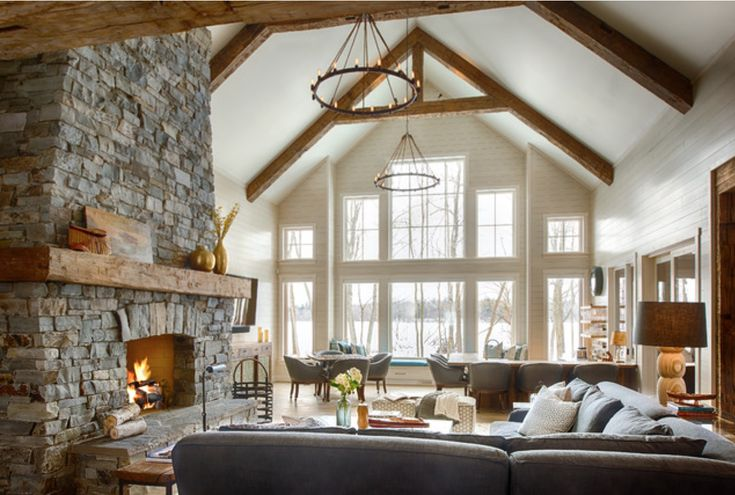 Stacked Stone Fireplace And Vaulted Ceiling With Exposed