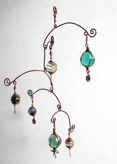 Love the shape of this mobile! - - - Copper wire