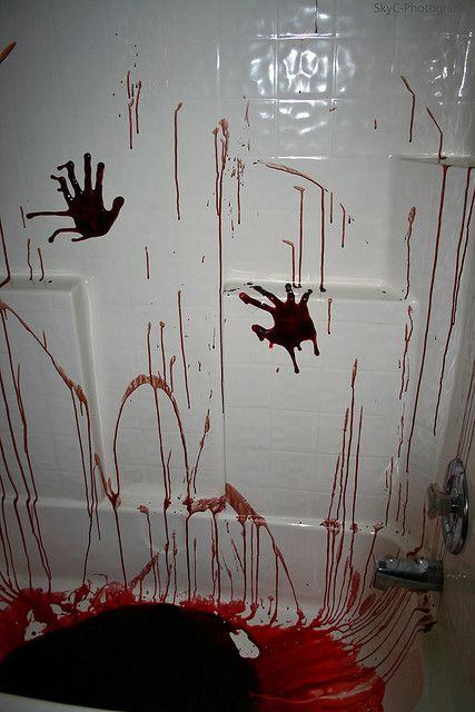 this is what my mom did to my bathroom for our halloween party all i did was put the handprints she did the blood splatters - Halloween Bathroom Decor