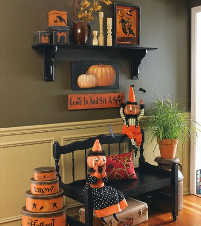 primitive halloween....love the black and oddly enough I like that wall color...already have the picture frame molding