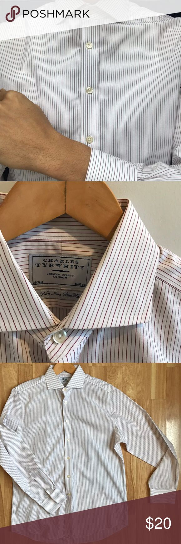 "Charles Tyrwhitt Spread Collar Slim Fit Non-iron Charles Tyrwhitt Jermyn Street London spread collar cotton dress shirt in white with gold and burgundy pinstripes. Premium quality cotton button down shirt with crisp spread collar and cuffs. Modern Slim fit design for fits nicely for an athletic look. English double button cuffs. Contrasts well with dark colors. Sophisticated european look.  Size: 16"" Sleeve: 34-35""  Chest: 44""  Length: 33"" Color: White with gold and burgundy Fabric: 100%…"