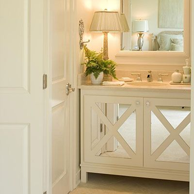 A cabinet vanity could overwhelm a tiny room. By matching the cabinet color to the wall color and applying mirrors to the cabinet doors, the room feels more open.