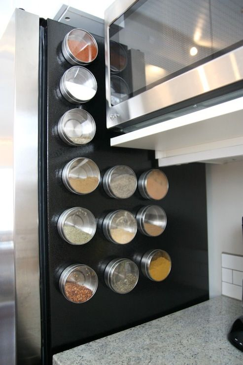 Instead of posting family photos or coupons on the fridge, why not use the space to store go-to spices stored in magnetic containers? Keeps favorite spices right at hand. And it maximizes all available space in otherwise space-challenged kitchens.