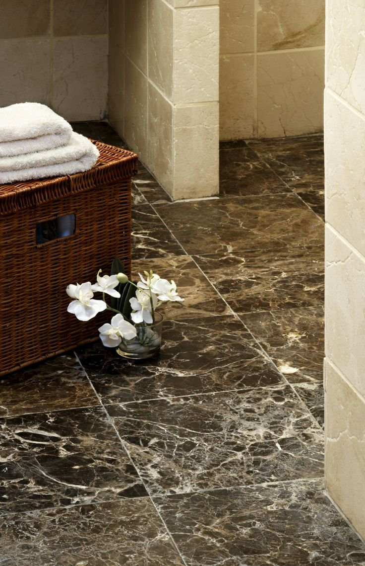 Marble floor tiles create a timeless look in your bathroom for Brown marble bathroom accessories