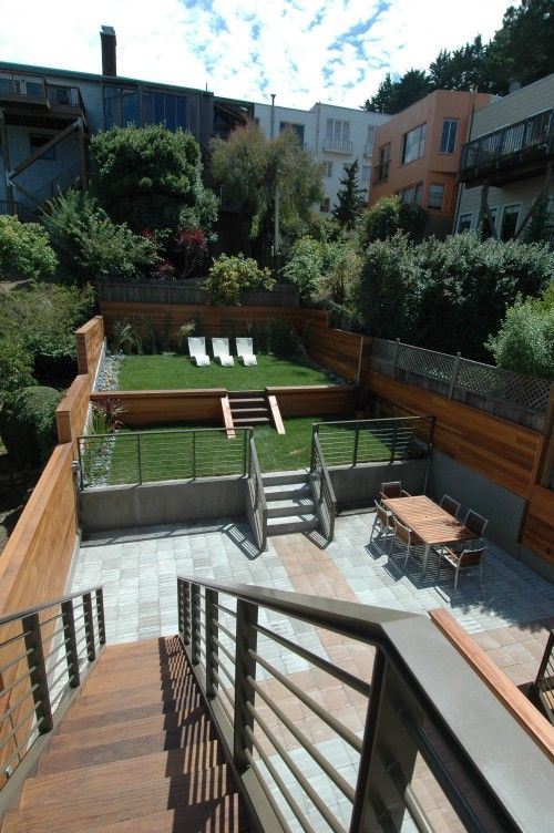 expand the back patio beyond the stairs, add chaises
