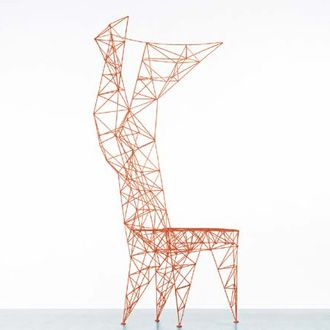 This chair is made from a wire structure. It is very basic and does not have any material over it making it look very unfinished. It reminds me of power lines
