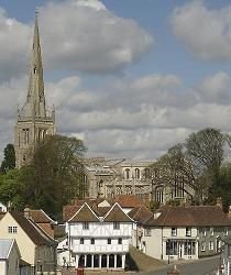 Thaxted in Essex, England, showing St John's Church which was built in 1340 and renowned for its flying buttress spire, which is 181 feet tall and the only medieval stone spire in the county.