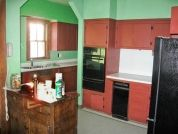 """Updated in the 1950s, the cook space was cut in two by an awkwardly placed arch, resulting in a choppy, impractical layout. """"I really wanted to improve the work area,"""" says Rose Marie Carr of Kitchens by Rose, """"and to make the kitchen look like it belonged to the rest of the house."""" And Dawn wanted a green renovation. When the crew went to rip up the pine floors, she scraped off the linoleum herself—soaking it in hot water to avoid potential asbestos fibers&#..."""