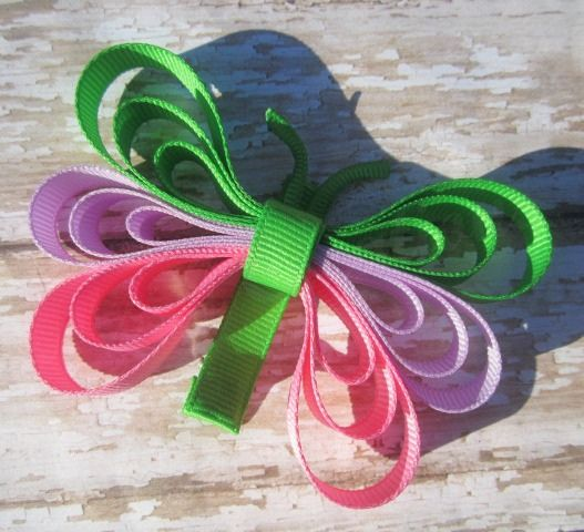 Green, purple, pink butterfly clip.