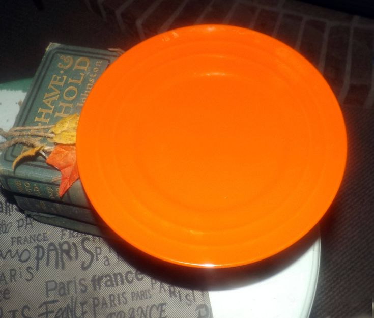 Discontinued 2012 Rachael Ray Double Ridge Tangerine pattern salad or side plate.  All-orange | tangerine with ridged details.