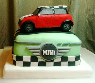 Mini cooper cake! Could do the British flag on the base as well.