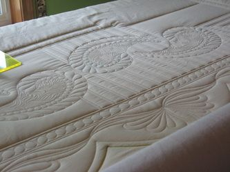 View the slideshow of quilts that I have quilted below. Some of these quilts are ones I have made and own, many of them belong to customers who I have quilted for them. This wholecloth quilt to...