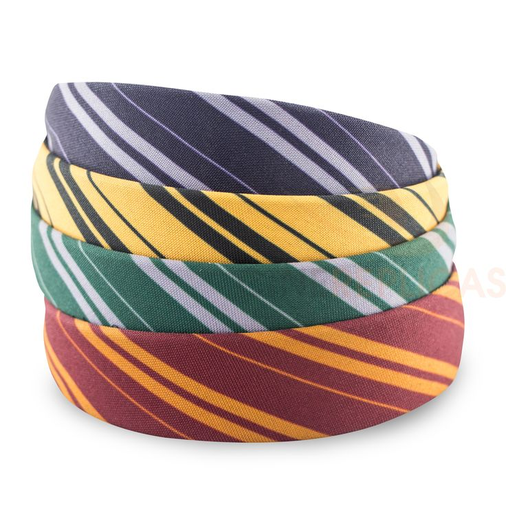 Gryffindor / Hufflepuff / Ravenclaw / Slytherin Headband striped in house colors from Hogwarts - Harry Potter™ Warner Bros Licensed cinereplicas.com Width of band is approx 15/16 inches From Cinereplicas