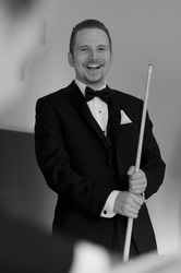 Groom in tuxedo with pool cue.  #torontoweddingphotography #torontoweddingvideography #weddingphotography #torontoweddings #torontowedding #culturalwedding #torontophotographer #torontovideographer #weddingvideography #torontobride