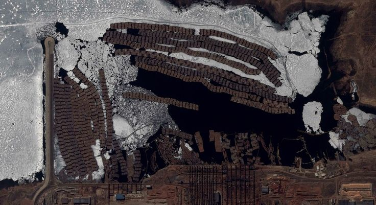 12/28/2014 Bratsk Pulp Mill Bratsk, Russia 56.113654870°, 101.602842593°  Timber is frozen in the Angara River by a pulp mill in Bratsk, Russia. A pulp mill is a manufacturing facility that converts trees and wood chips into thick fiber board that is shipped to a paper mill for further processing. The facility in Bratsk has a capacity of 413,000 cubic meters of wood per year.