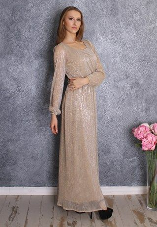 Sparkling gold dress with long sleeves coming soon to Mode-sty