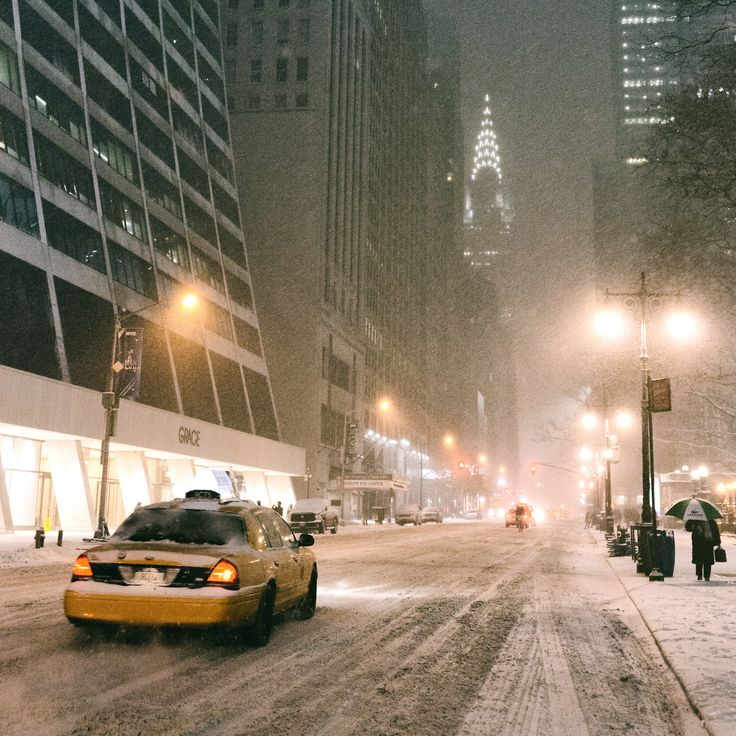 New York City - Snow at night looking towards the Chrysler Building