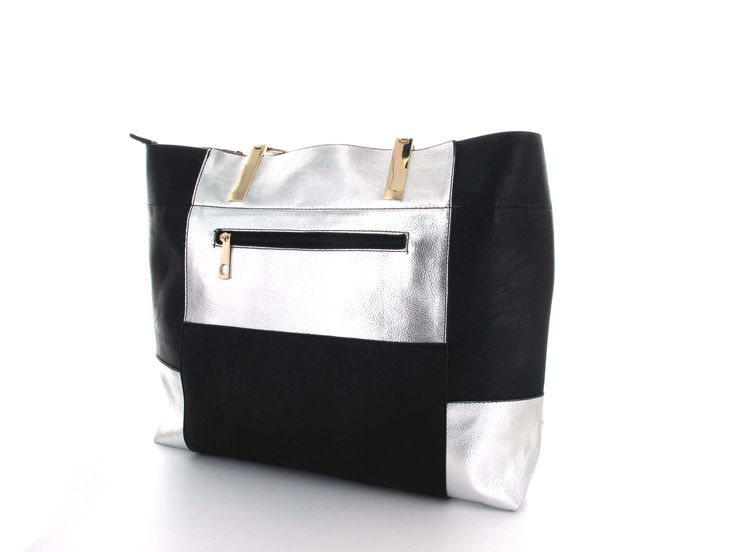 Metallic Silver Colour Block Tote A top handle tote with a stunning large patchwork pattern featuring metallic and black squares. Includes a top zipper, to kepp items safe and secure. Smooth surface is easy to care for and clean.   Available in; Gold/Black and Silver/Black.