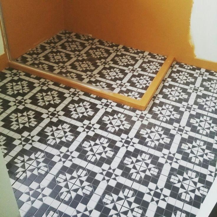 Bathroom tile going down.