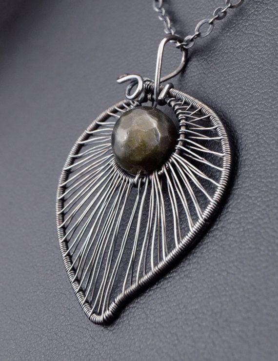 A delicate, unique, handmade, wire wrapped pendant with Larvikite.  Pendant was designed and made by Me, using an extremely labor-intensive and precise wire-wrapping technique, with silver 925, 930 and 999. Strongly oxidized and polished to emphasize the braid tangles.  Dimensions of pendant: length: 4,4 cm (1.73 inch) width: 3,2 cm (1.25 inch)  You receive this unique pendant in jewelry box, so it is ready to be a gift.  ---On this auction You buy ONLY pendant without chain.----  Another…