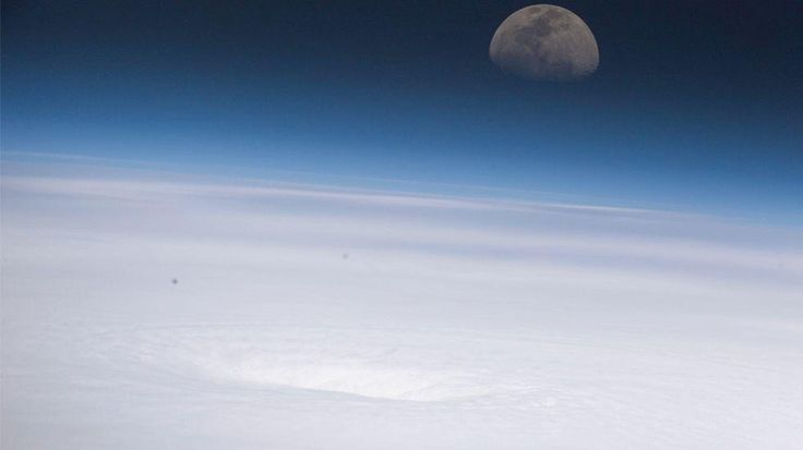 Emily - 2005 (NASA) The crew aboard the International Space Station captured this stunning image showing the eye of Hurricane Emily (lower center) with the moon rising in the background. Emily was a strengthening Category 4 hurricane southwest of Jamaica the time this image was taken on July 16, 2005.