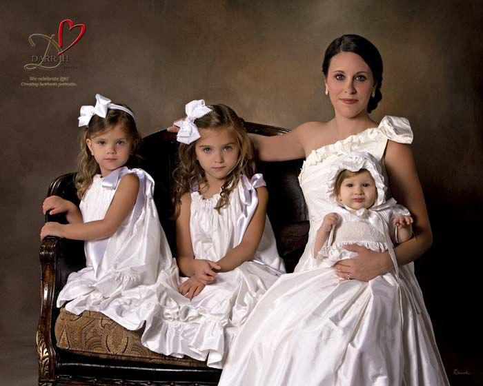 Stunning mom with daughters portrait.