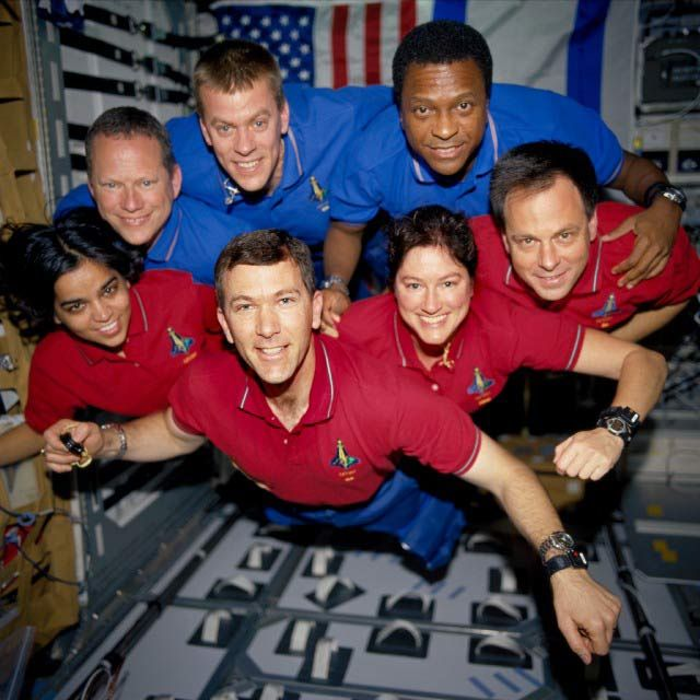 This image of the STS-107 crew in orbit was recovered from wreckage inside an undeveloped film canister. The shirt color's indicate their mission shifts. From left (bottom row): Kalpana Chawla, mission specialist; Rick Husband, commander; Laurel Clark, mission specialist; and Ilan Ramon, payload specialist. From left (top row) are astronauts David Brown, mission specialist; William McCool, pilot; and Michael Anderson, payload commander. Ramon represents the Israeli Space Agency.