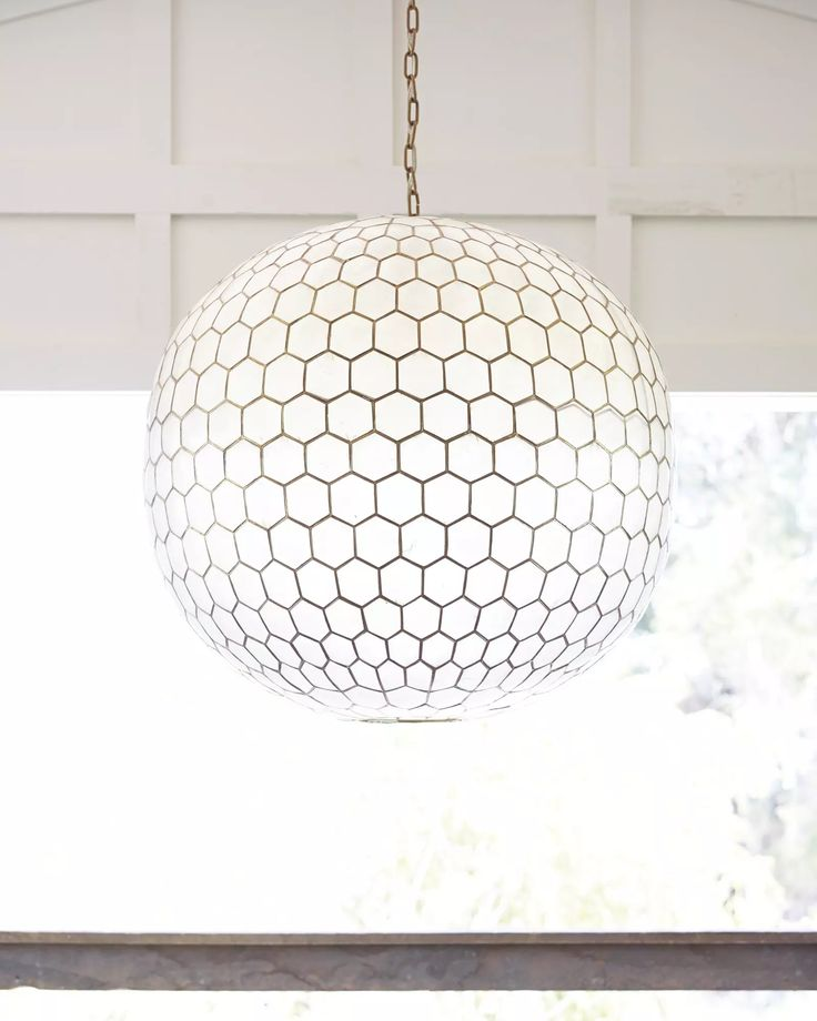 Capiz Honeycomb Chandelier - Serena and Lily.  Over dining table.  Would lighten and modernize space.  Great with white anthro chairs