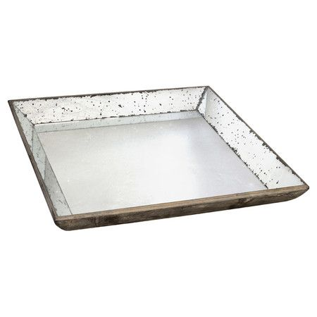 Use with a stool for a side tabletop?   Featuring a mirrored surface and distressed detailing,  this elegant tray is a glittering canvas for an eclectic candle arrangement or vase of bright blooms.