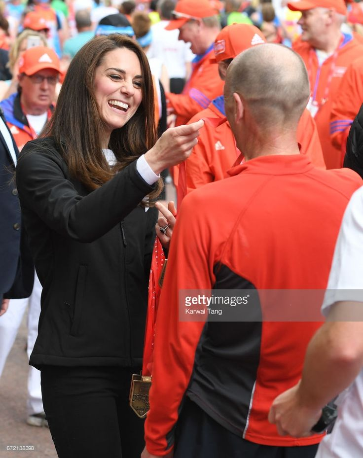 News Photo : Catherine, Duchess of Cambridge gives out medals...