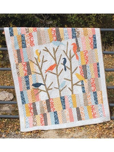 "These sweet applique birds will make a charming addition to your wall or as a darling lap quilt. Use up some fun scraps or a new fabric collection -- either style will make a charming statement. Finished size is 60"" x 70""."