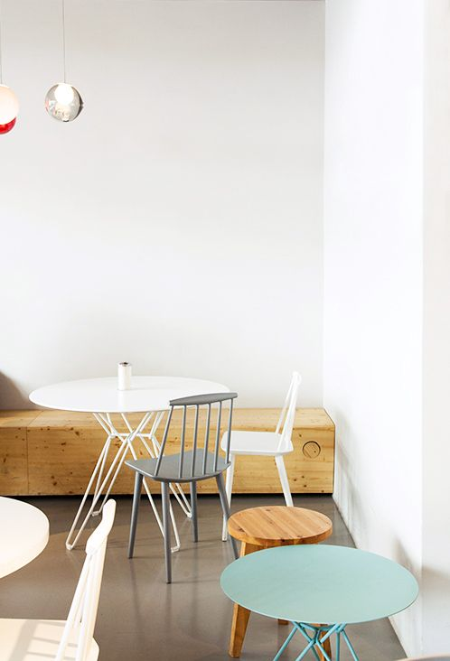 foreign correspondent: westberlin coffee shop. Simple, elegant and wood benches running along the walls.