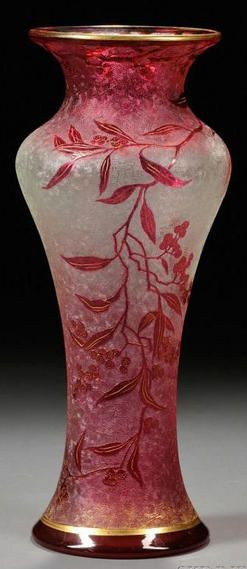 glass, France, An Art Nouveau Cameo art glass vase, France, early 20th century, flaring rim on vasiform body of cranberry red cameo glass shaded to clear in a berry and vine decoration with gilt highlights, clear flat base,  circa 1901-1925