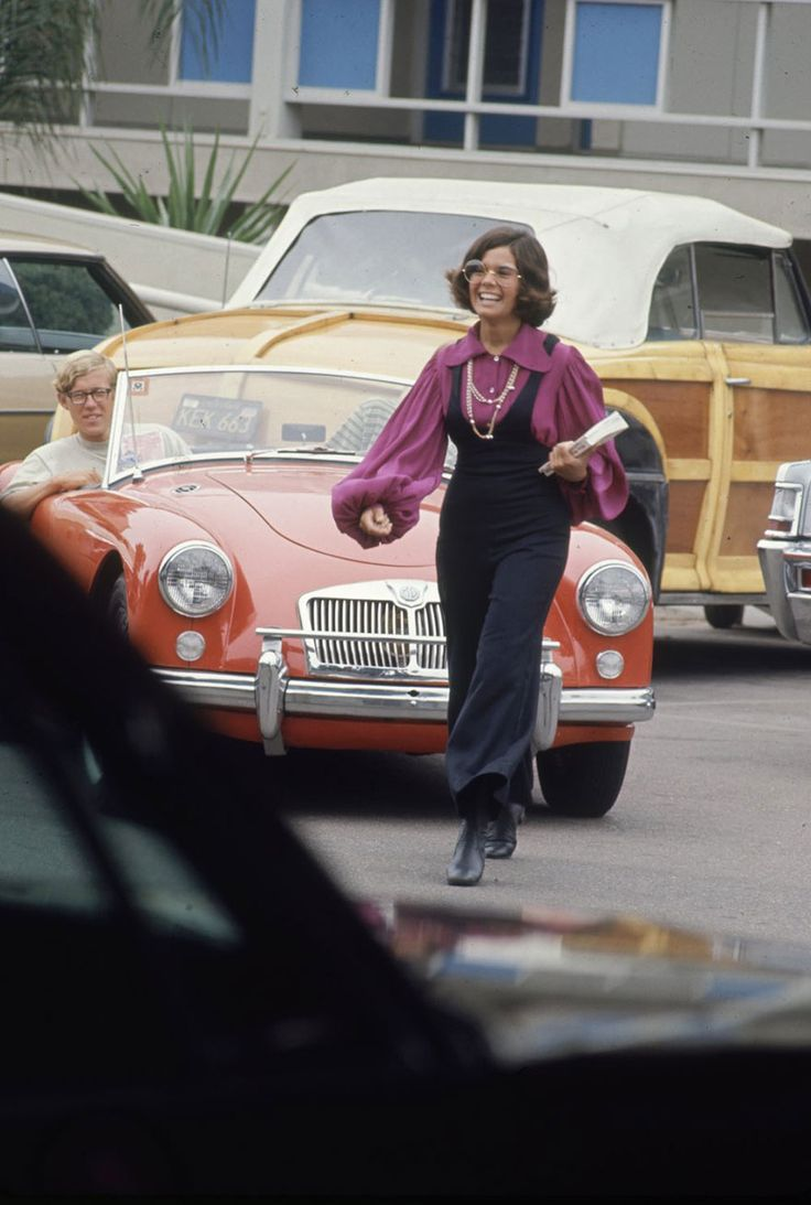 """High schooler Lenore Reday stops traffic while wearing a bell-bottomed jump suit in Newport Beach, Calif., 1969."""