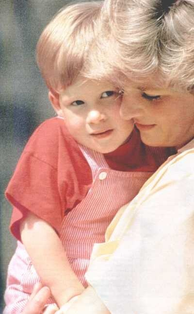 Diana with Harry in 1986 visiting Majorca, Spain as guests of King Juan Carlos and Queen Sofia.